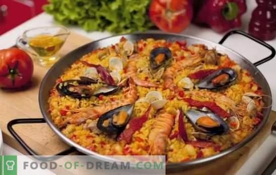 Paella z owocami morza - plov w stylu hiszpańskim. Gotowanie paelli z owocami morza i fasolą, kukurydzą, groszkiem, rybą